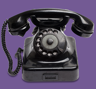 Old black phone suggests contacting us will lead to old-fashioned customer service